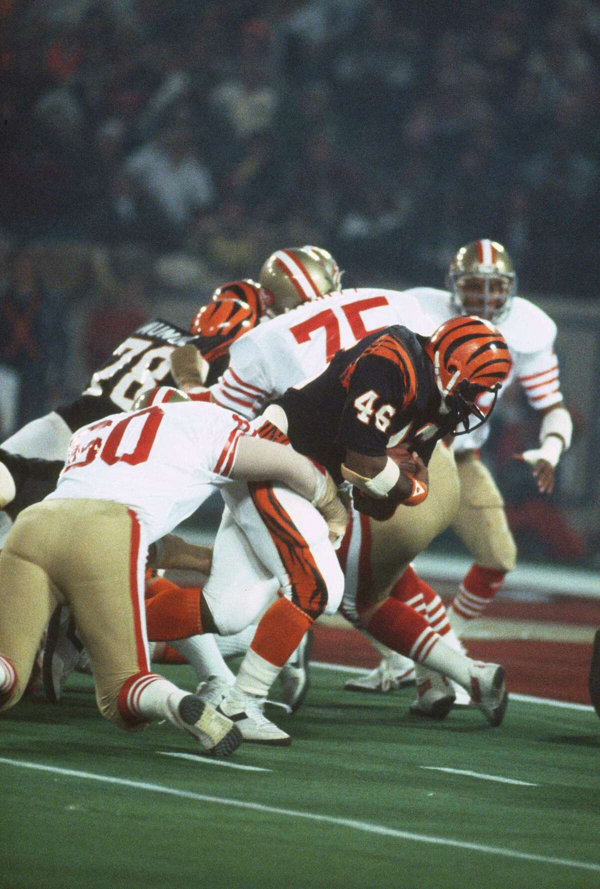 PONTIAC, MI - JANUARY 24: Pete Johnson #46 of the Cincinnati Bengals carries the ball against the San Francisco 49ers during Super Bowl XVI on January 24, 1982 at the Silverdome in Pontiac, Michigan. The Niners won the Super Bowl 26 -21. (Photo by Focus on Sport/Getty Images)