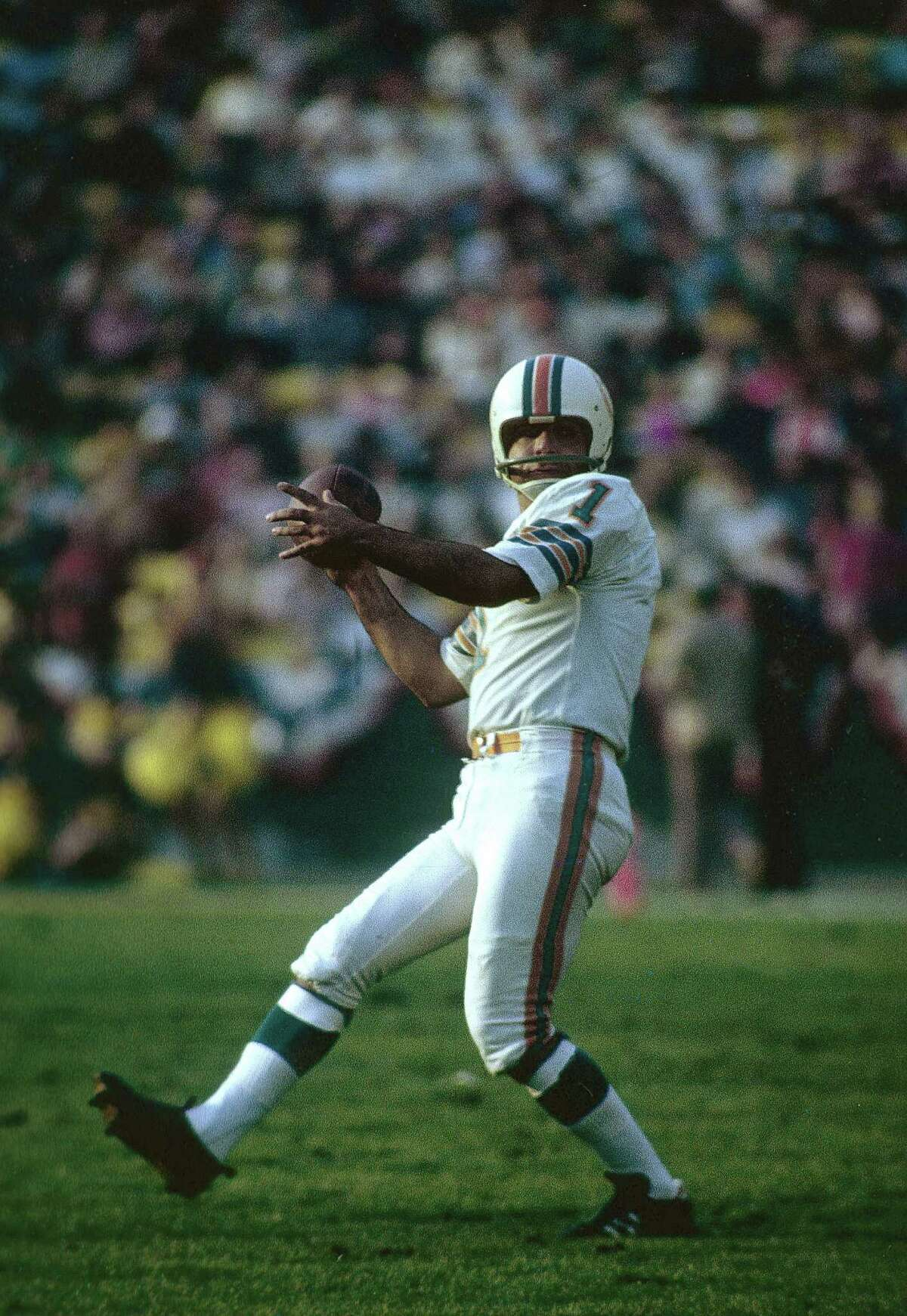 Garo Yepremian #1 looks to pass the ball after a botched field goal attempt against the Washington Redskins during Super Bowl VII at the Memorial Coliseum in Los Angeles, California, January 14, 1973. The Dolphins won the Super Bowl 14-7. (Photo by Focus on Sport/Getty Images)
