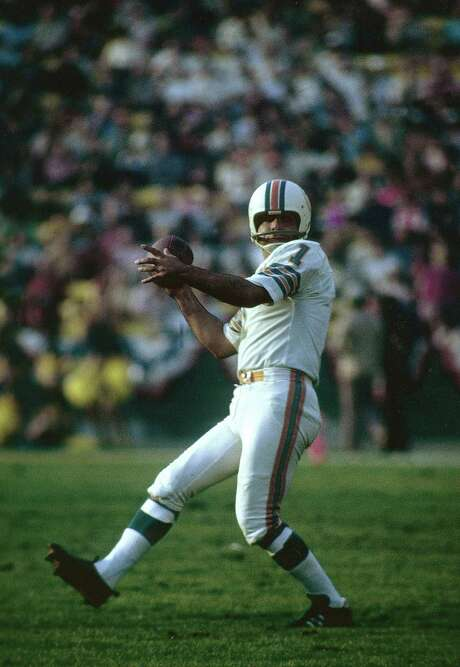 LOS ANGELES, CA - JANUARY 14:  Garo Yepremian #1 looks to pass the ball after a botched field goal attempt against the Washington Redskins during Super Bowl VII at the Memorial Coliseum in Los Angeles, California, January 14, 1973. The Dolphins won the Super Bowl 14-7. (Photo by Focus on Sport/Getty Images)