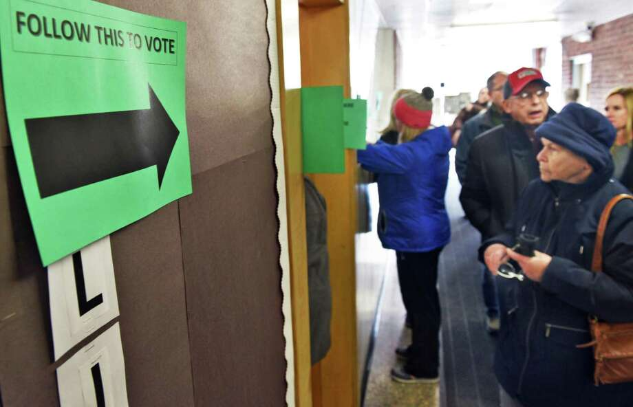 Voters arrive to cast their ballots on a $196.4 million North Colonie building project to renovate and expand all district schools Thursday Dec. 15, 2016 in Colonie, NY.  (John Carl D'Annibale / Times Union) Photo: John Carl D'Annibale / 20039141A