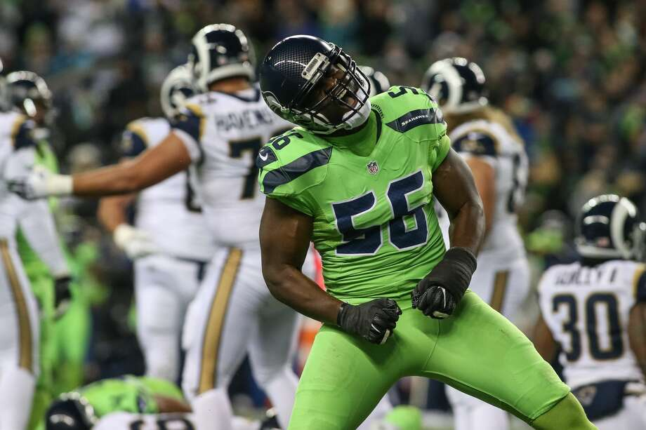 Defensive end Cliff Avril and the Seattle Seahawks embark on their latest postseason run when they take on the Detroit Lions in an NFC wild-card round matchup at CenturyLink Field on Saturday night. Check out the gallery for memorable playoff moments from Seattle's sports history. Photo: SPENSER HEAPS, SPECIAL TO SEATTLEPI.COM