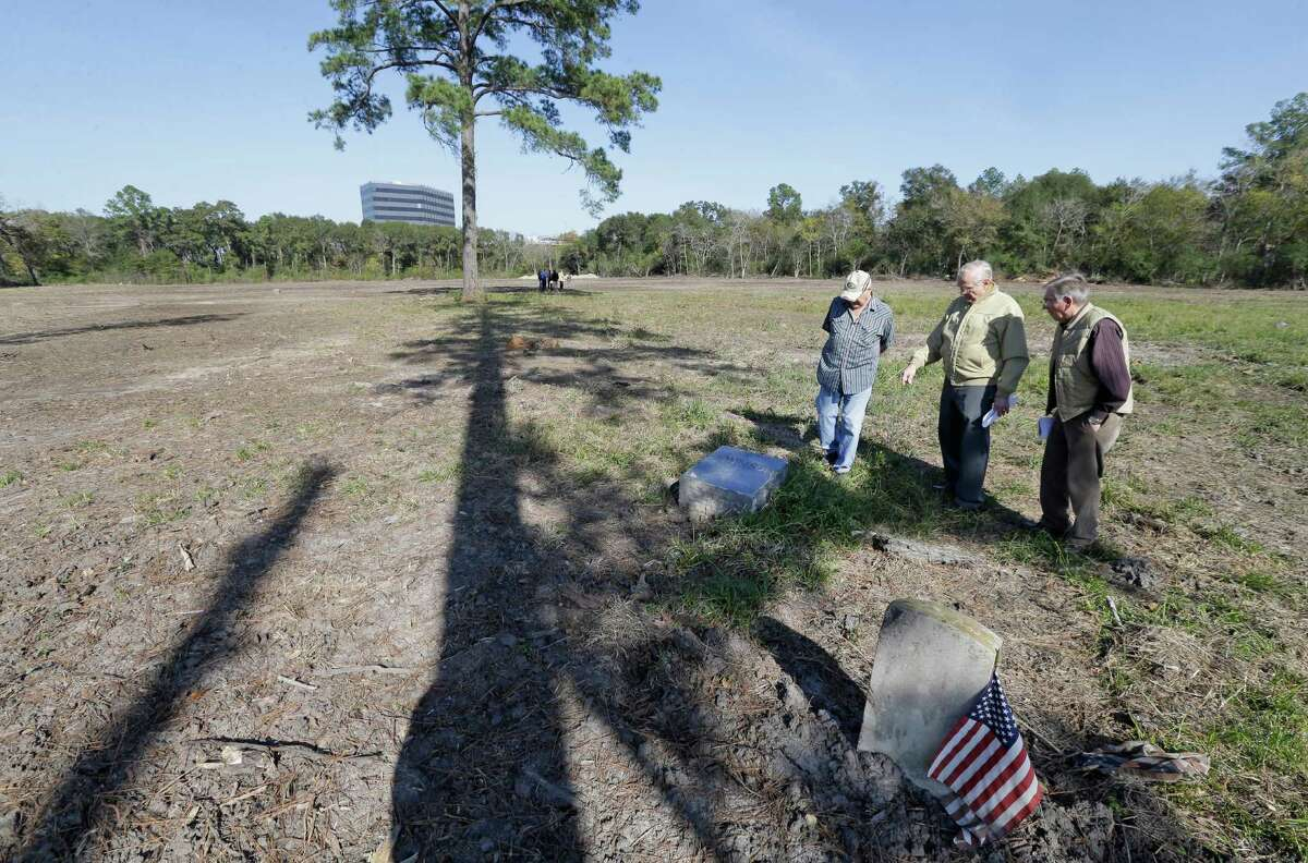 From left, Frank Price, Alfred Seeliger and Edgar Reeves talk about the desecration of graves in Aldine Cemetery. In addition to damaging headstones and grave markers, a crew also removed many trees.