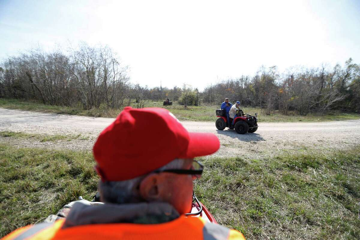 Volunteers with EquuSearch use ATVs to look for Anne-Christine Johnson in League City. The missing 30-year-old woman was last seen on Dec. 8 in a white car with an unidentified man.