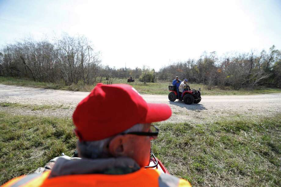 Volunteers with EquuSearch use ATVs to look for Anne-Christine Johnson in League City. The missing 30-year-old woman was last seen on Dec. 8 in a white car with an unidentified man. Photo: Karen Warren, Staff Photographer / 2016 Houston Chronicle