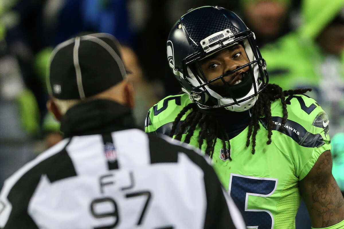 Seattle Seahawks cornerback Richard Sherman argues with a referee after nearly intercepting a Los Angeles Rams pass in the end zone in the first half of a football game at CenturyLink Field on Thursday, Dec. 15, 2016.
