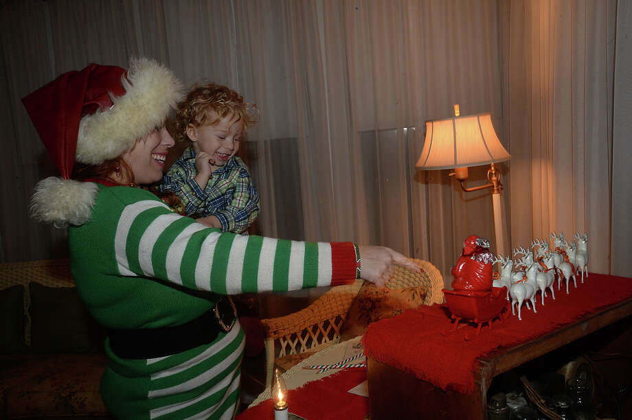 Rachel Shajari and son Aidan, 2, enjoy taking in the holiday decor at Thursday night's A Vintage Christmas at the Chambers House. Visitors got a glimpse into Christmas past as vintage ornaments, cards, and toys decorated the historic home, reflecting on the family's holiday celebrations from the 1920's through the '40's. Refreshments were served and musical entertainment was provided by the Sweet Adelines, who kept the festivities alive with their a cappella renditions of Christmas carol classics.  Photo taken Thursday, December 15, 2016 Kim Brent/The Enterprise Photo: Kim Brent / Beaumont Enterprise