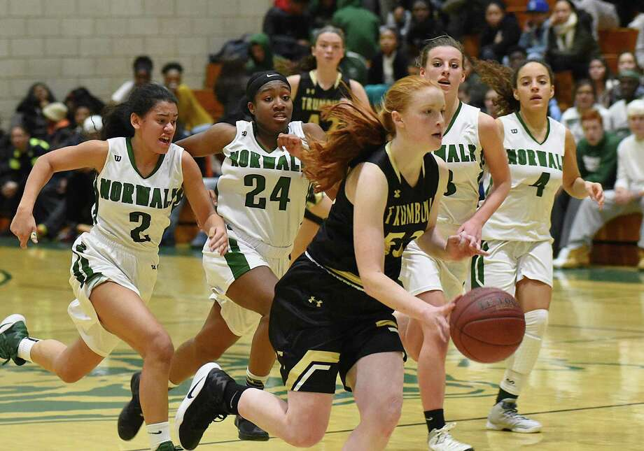 Trumbull's Taylor Brown, front, races to the hoop, trailed by Norwalk players, from left, Ashley Wilson, Sanaa Boyd, Amanda Beckwith, and Ajsa Vega during the second half of Thursday's FCIAC girls basketball game at Scarso Gym in Norwalk. Trumbull beat Norwalk 54-47. Photo: John Nash / Hearst Connecticut Media / Norwalk Hour