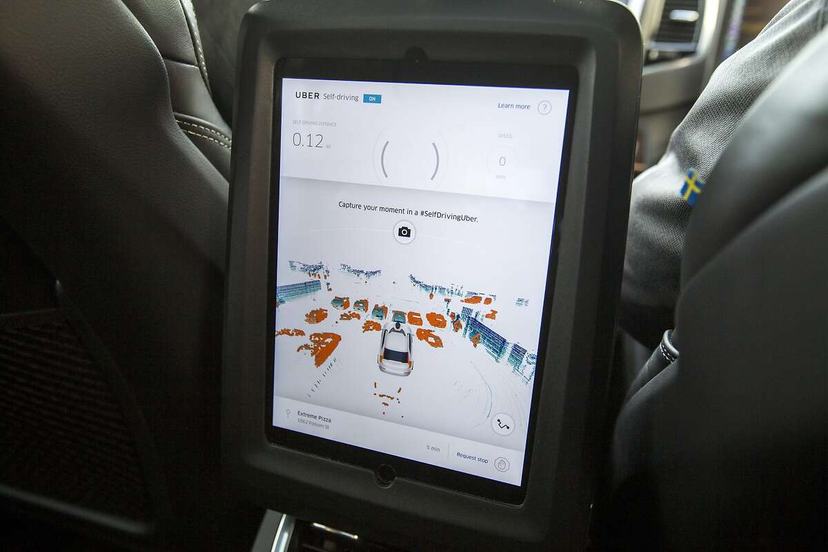 The display shows what Uber's self-driving Volvo XC90 SUV sees during a test drive in downtown San Francisco on Tuesday, Dec. 13, 2016 in San Francisco, Calif. The screen is produced with the help of LIDAR, a laser system that maps out the car's surroundings, that is attached to the top of the roof.