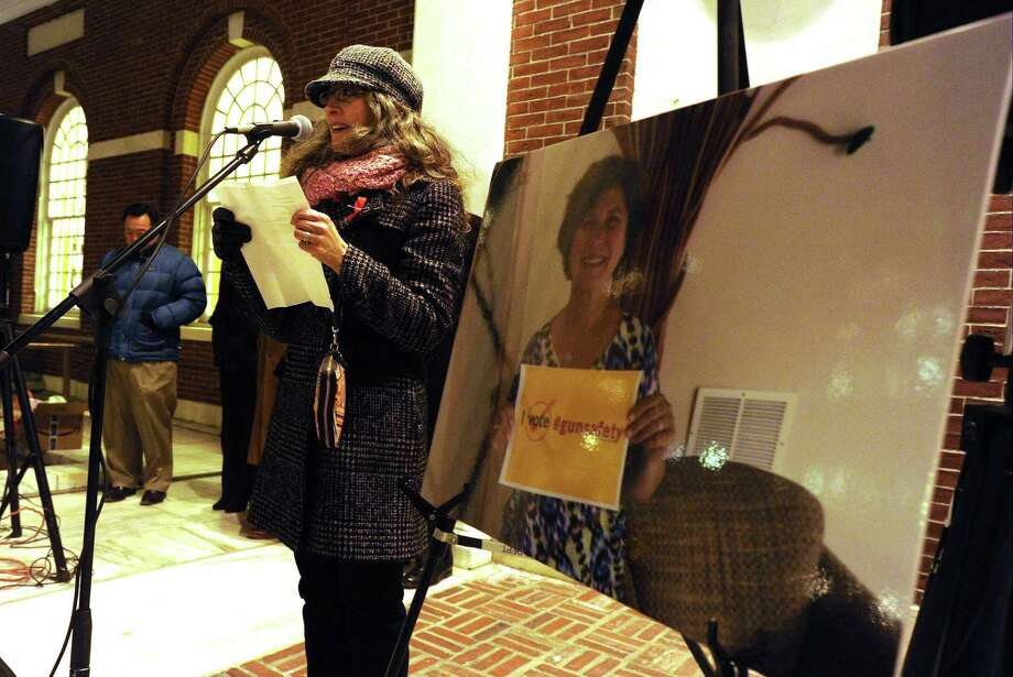 Shira Tarantino with The ENOUGH Campaign stands with a photo of Judith Martin, Stamford Mayor David Martin late wife, who was an out spoken advocate to end gun violence, as she welcomes attendees to the fourth annual Stamford Vigil of Hope to End Gun Violence in front of Ferguson Library in Stamford on Dec. 15, 2016. The event attended by two dozen individuals which included civic and state representatives honored the lives lost to the epidemic of gun violence in America, one day after the fourth anniversary of the Sandy Hook shootings. Photo: Matthew Brown / Hearst Connecticut Media / Stamford Advocate
