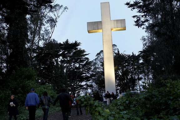People made the hike up Mount Davidson as the sun rose on Easter Sunday. The 90th annual Mount Davidson Easter Sunrise Service was held Sunday April 8, 2012 to a grateful crowd.