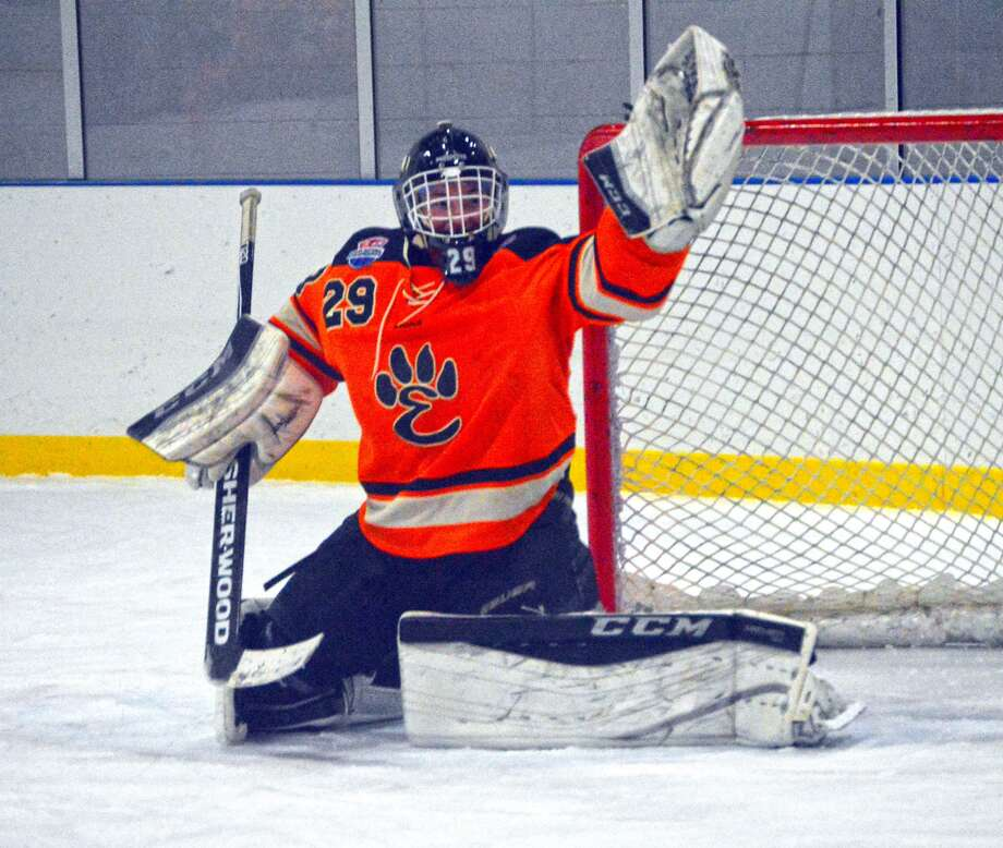 Edwardsville goalie Matt Griffin makes a glove save early in the third period against Saint Louis University High on Thursday at Kennedy Ice Rink.