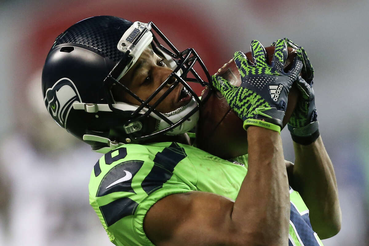 Seattle Seahawks wide receiver Tyler Lockett catches a pass from quarterback Russell Wilson for a touchdown in the second half against the Los Angeles Rams at CenturyLink Field on Thursday, Dec. 15, 2016. (GRANT HINDSLEY, seattlepi.com)