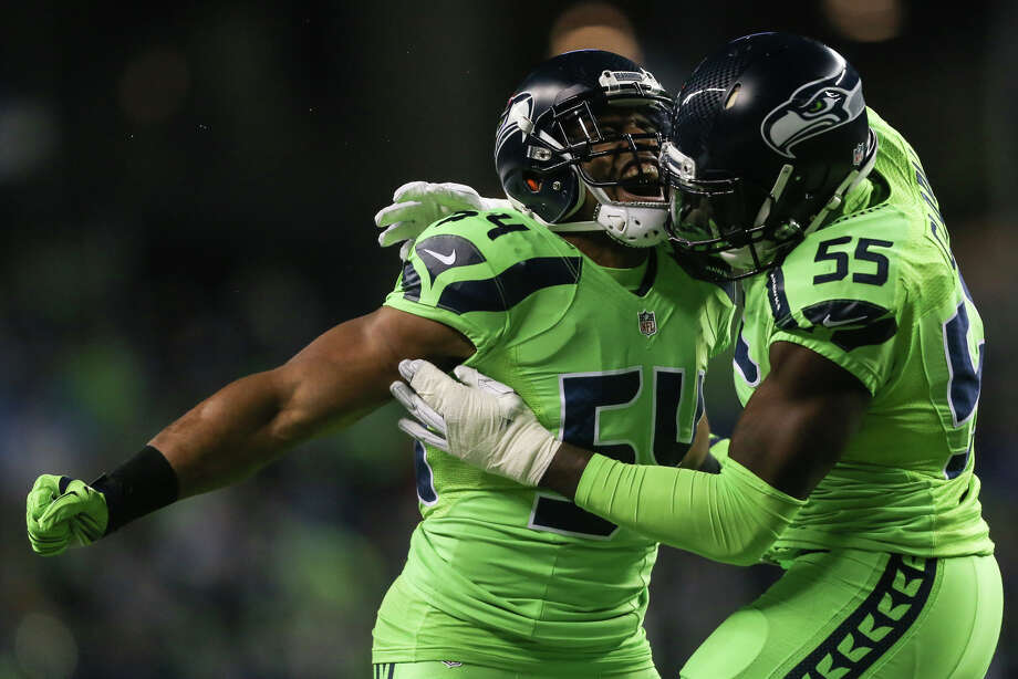 Seattle Seahawks middle linebacker Bobby Wagner celebrates Seattle Seahawks defensive end Frank Clark's sack during a football game against the Los Angeles Rams at CenturyLink Field on Thursday, Dec. 15, 2016. (GRANT HINDSLEY, seattlepi.com) Photo: GRANT HINDSLEY/SEATTLEPI.COM