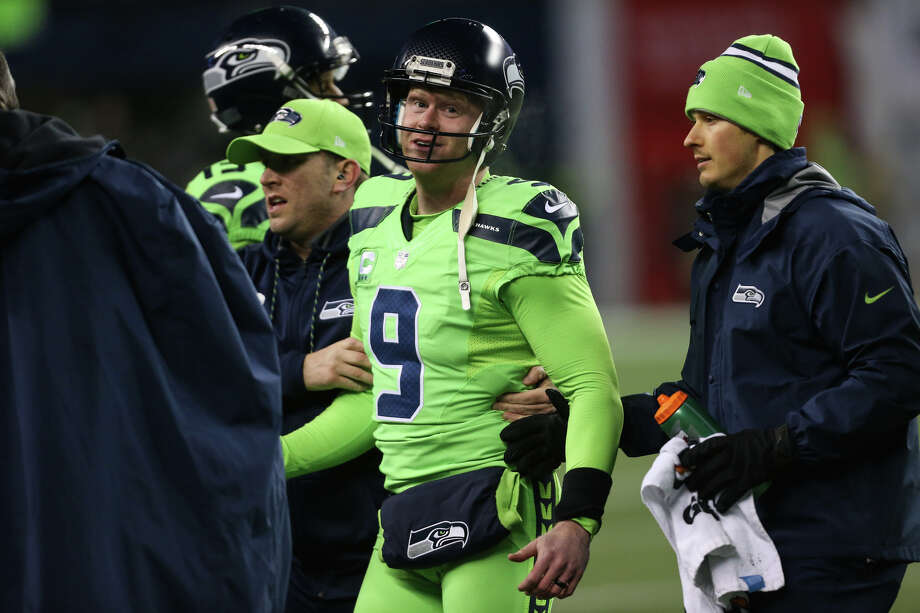 Seattle Seahawks punter Jon Ryan walks off the field after being hit hard during a trick play for a 4th down conversion in the second half against the Los Angeles Rams at CenturyLink Field on Thursday, Dec. 15, 2016. (GRANT HINDSLEY, seattlepi.com) Photo: GRANT HINDSLEY/SEATTLEPI.COM