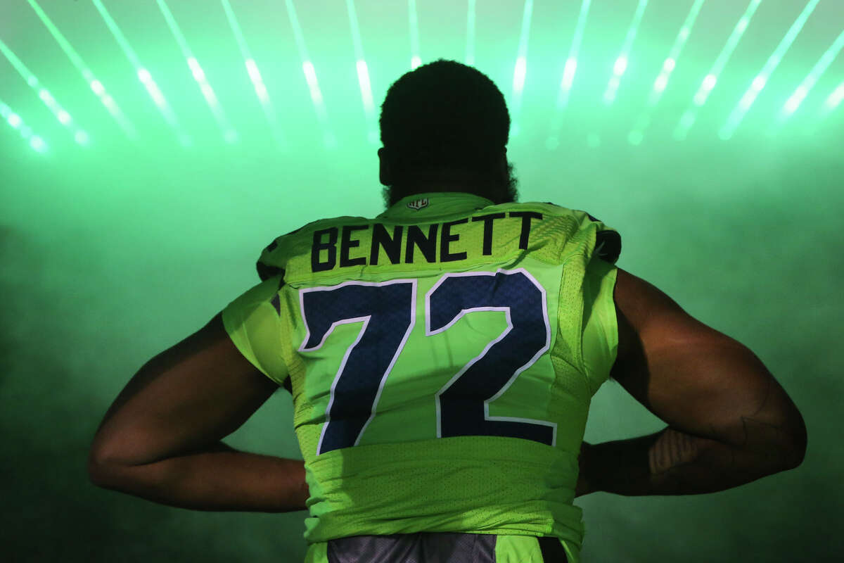 Seattle Seahawks defensive end Michael Bennett is introduced before the Seahawks take on the Los Angeles Rams at CenturyLink Field on Thursday, Dec. 15, 2016. (GRANT HINDSLEY, seattlepi.com)