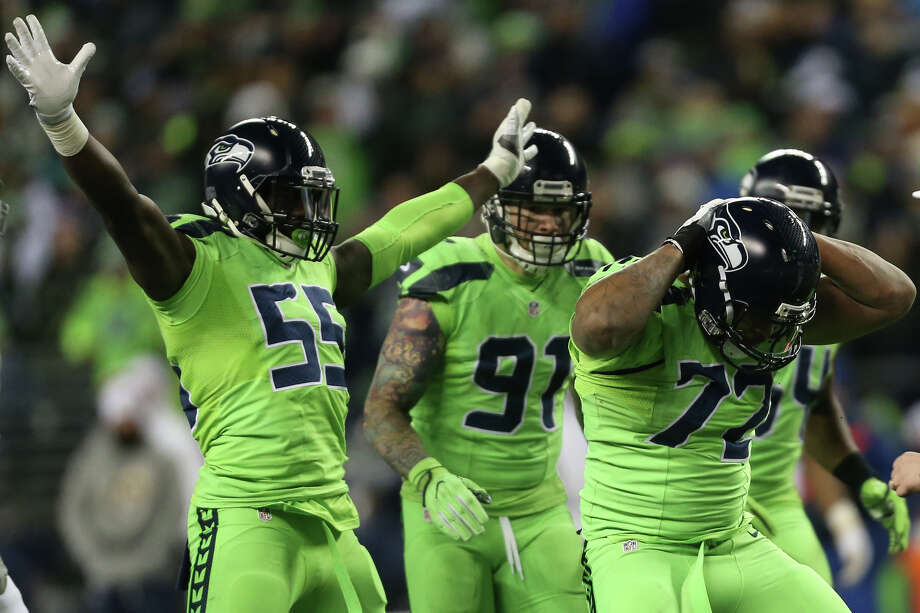 Seattle Seahawks defensive end Michael Bennett and defensive end Frank Clark celebrate a sack while playing the Los Angeles Rams at CenturyLink Field on Thursday, Dec. 15, 2016. (GRANT HINDSLEY, seattlepi.com) Photo: GRANT HINDSLEY/SEATTLEPI.COM