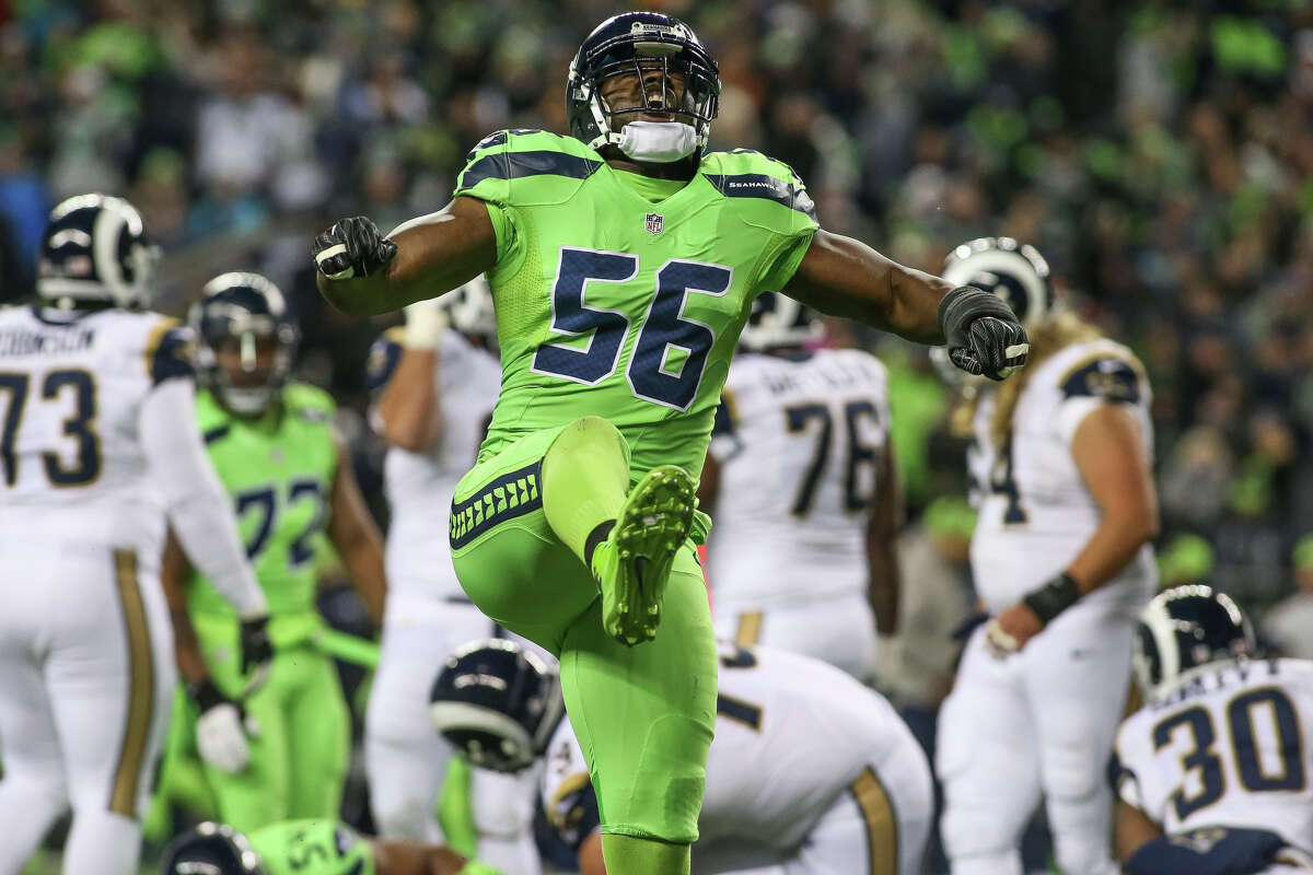 Seattle Seahawks defensive end Cliff Avril (56) celebrates after sacking Los Angeles Rams quarterback Jared Goff (16) during a football game at CenturyLink Field on Thursday, Dec. 15, 2016. (SPENSER HEAPS, seattlepi.com)