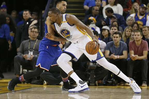 Golden State Warriors forward Kevin Durant (35) drives to the basket against New York Knicks guard Courtney Lee (5) during the second half of a NBA game at Oracle Arena in Oakland, Calif., on Thursday, Dec. 15, 2016. Warriors won 103-90.