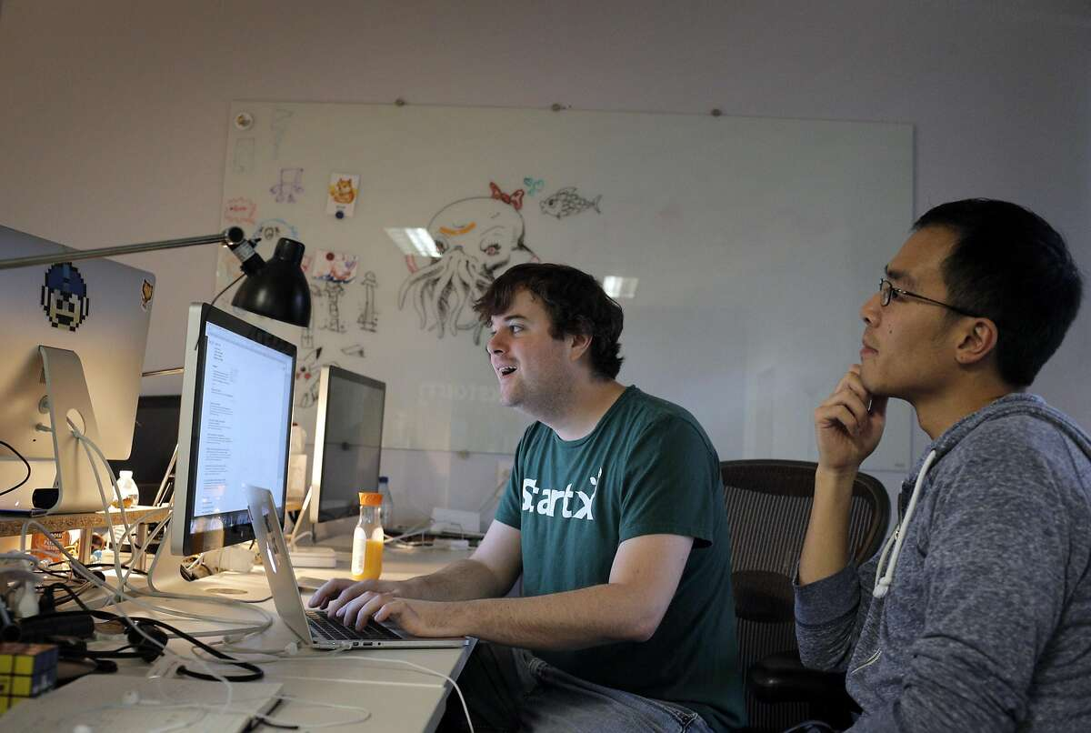 Jimmy Griffith, Studio Head, left, works with Raymond Yang, Community Manager, right, on EverWing at the Blackstorm headquarters in Mountain View, Calif., on Wednesday, December 14, 2016. Mountain View-based Blackstorm creates software that it licenses to companies so that the firms can embed their apps within other popular apps like Facebook, without having consumers download an additional separate app though a cumbersome process through the Apple App or Google Play stores.