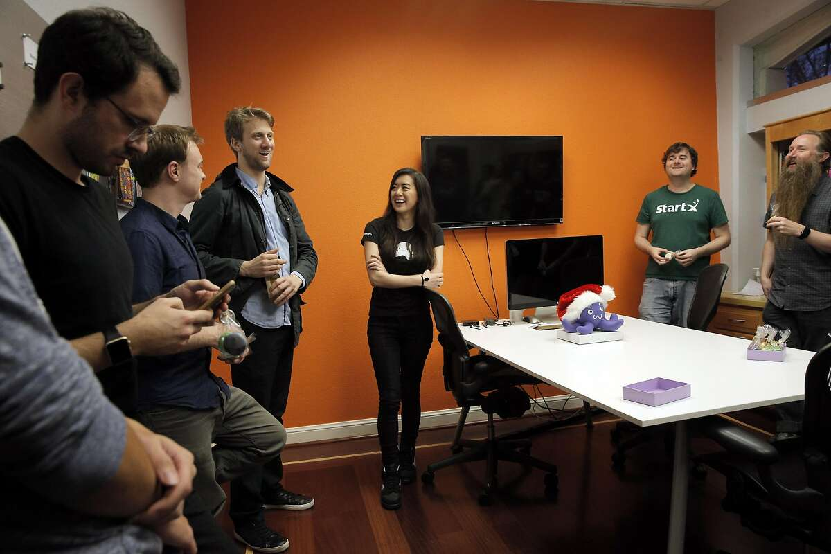 Michael Piech, left, and Ernestine Fu, speak to employees during a meeting at the Blackstorm headquarters in Mountain View, Calif., on Wednesday, December 14, 2016. Mountain View-based Blackstorm creates software that it licenses to companies so that the firms can embed their apps within other popular apps like Facebook, without having consumers download an additional separate app though a cumbersome process through the Apple App or Google Play stores.