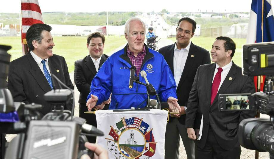 In this December 2016 file photo, U.S. Sen. John Cornyn, R-TX, speaks about the Cross Border Trade Enhancement Act at the World Trade Bridge. He was joined by U.S. representatives Henry Cuellar and Will Hurd. Photo: Danny Zaragoza /Laredo Morning Times / LAREDO MORNING TIMES
