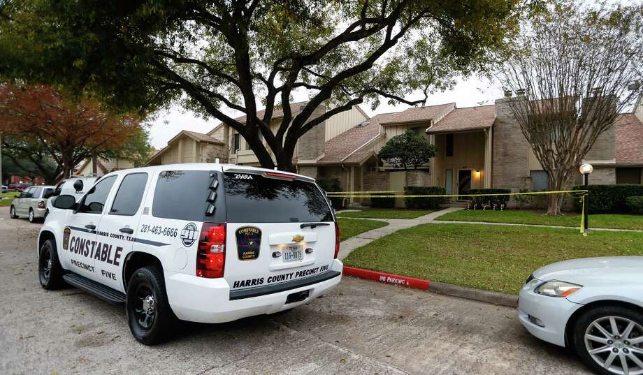 Harris County Constables outside of the home on Garden Grove Court where a son fatally stabbed his 48-year-old mother early Friday morning in her southwest Harris County townhome, according to the Harris County Sheriff's office, Dec 16, 2016. Photo: Karen Warren / Houston Chronicle