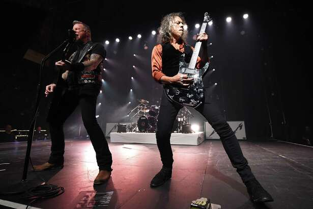 LOS ANGELES, CA - DECEMBER 15:  Musicians James Hetfield (L) and Kirk Hammett of Metallica perform at the Fonda Theatre on December 15, 2016 in Los Angeles, California.