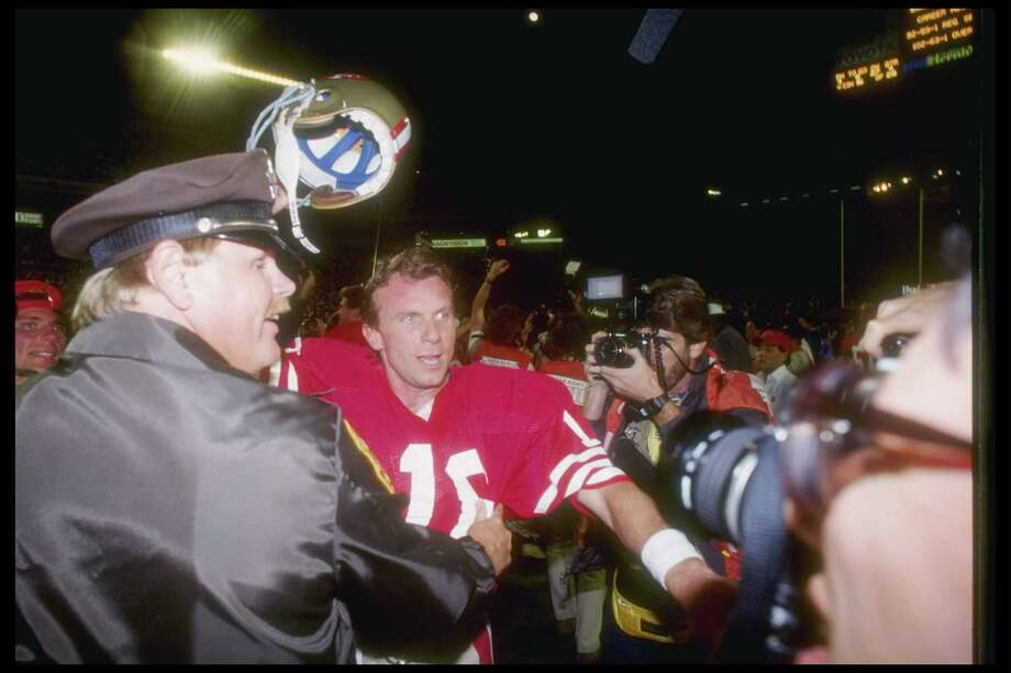 "No. 1: 'Hey, isn't that John Candy?'The game: Super Bowl XXIIIThe date: Jan. 22, 1989The setting: Joe Robbie Stadium, Miami Gardens, Fla.The protagonists: Joe Montana, Jerry Rice, John TaylorThe circumstances: With 3:10 left in the game, Cincinnati was leading 16-13 after Jim Breech's 40-yard field goal. San Francisco had taken over, first-and-10, at its 8-yard line following a half-the-distance penalty on the kickoff return.The moment: Trying to settle his teammates down before they broke from the huddle, Montana turned to tackle Harris Barton and called his attention to a familiar face in the stands. ""Hey,"" he said, ""isn't that John Candy?"" Super Joe then drove the 49ers 92 yards, rifling the winning 10-yard touchdown pass to Taylor with 34 seconds left. With 1:15 showing on the clock, the Niners had been facing a second-and-20 near midfield before Montana and Rice conspired to doom the Bengals for a second time in the Super Bowl. On a day when Rice would finish with 11 receptions for 215 yards and claim MVP honors, the most prolific receiver in NFL history snared a tightly threaded Montana ball over the top and high-stepped past three would-be Cincinnati tacklers, picking up 33 yards to the 18. Montana next found Roger Craig for a gain of 8 before Taylor, beating single coverage on a post pattern, scored the winning points.The upshot: With their third Lombardi Trophy in nine seasons and having won the most dramatic Super Bowl yet played, Bill Walsh's 49ers secured their legacy as one of the NFL's greatest teams. Just for fun, they added a fourth title under George Seifert the following season, routing the Denver Broncos 55-10 in Super Bowl XXIV. Photo: Rick Stewart, Getty Images / Getty Images North America"