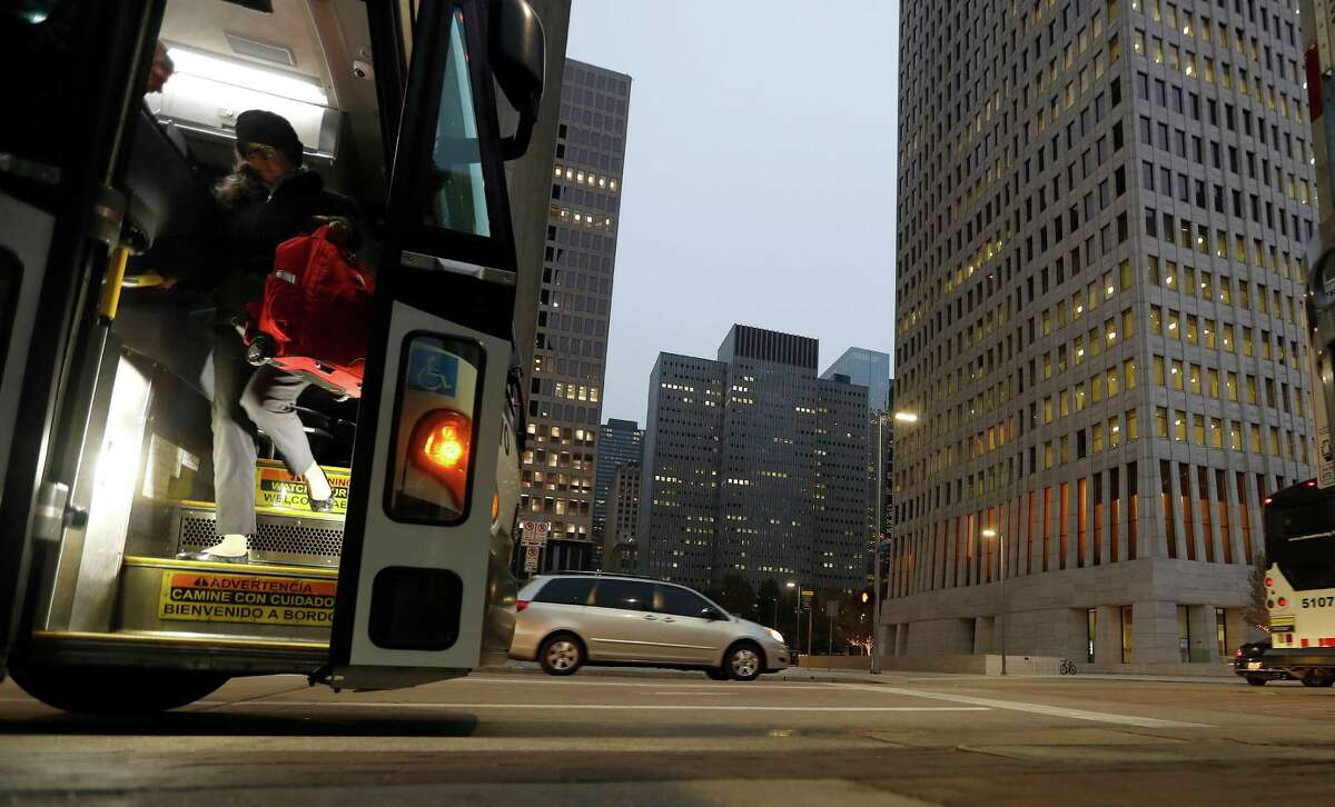 A Metro bus drops off passengers on Smith Street outside of One Shell Plaza in downtown Houston on Dec. 16.