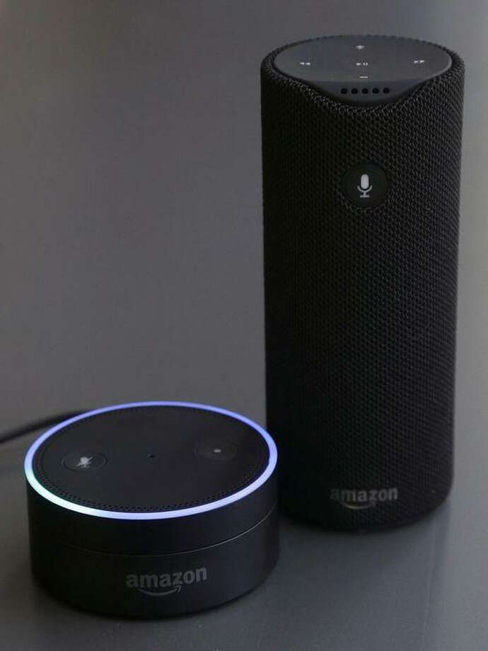 The Echo Dot, left, and the Amazon Tap are joining the Echo. Photo: Associated Press