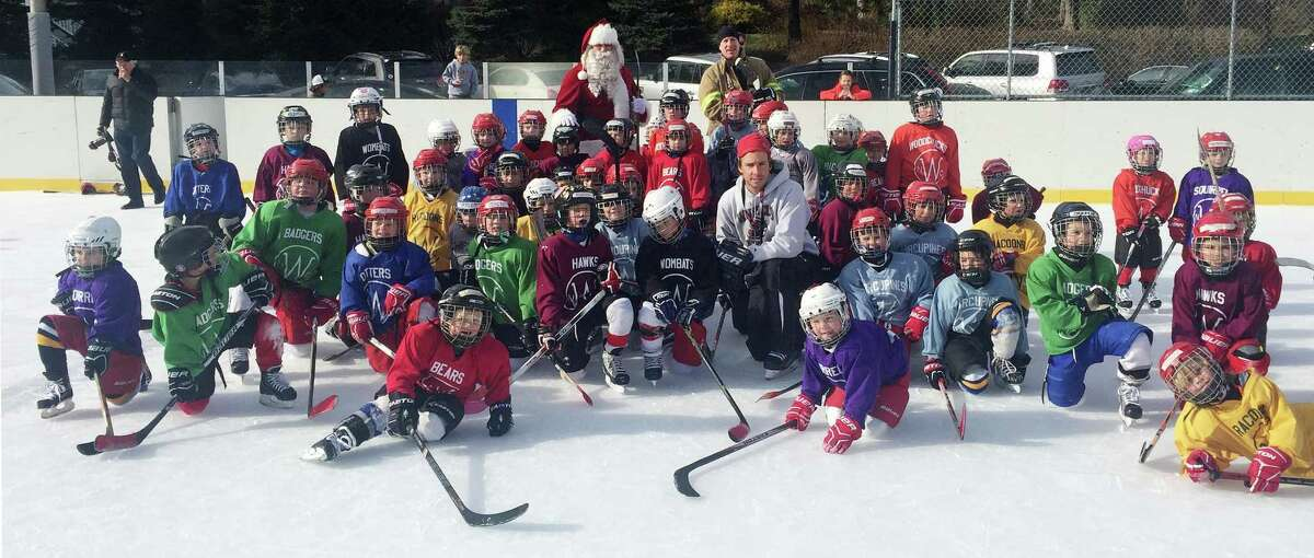 Skaters from New Canaan?'s Mite Development Program hang out with Santa, who showed up to the the New Canaan Winter Club on Frogtown Road on a fire truck Dec. 10.