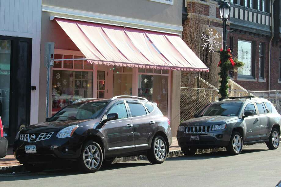 Benefit Cosmetics, located on the east side of Main Street, will lose the parking spots in front of the store during snow storms. Photo: Chris Marquette / Hearst Connecticut Media / Westport News