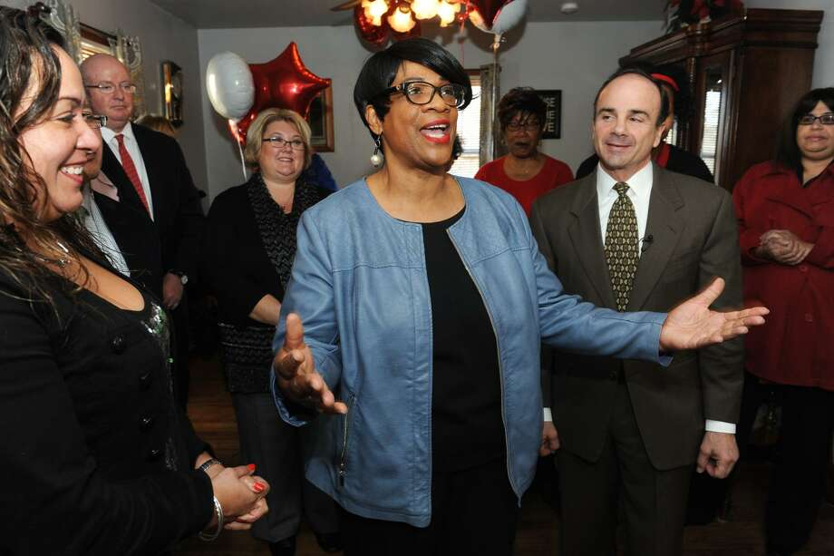 Joann Smith, seen here with Mayor Joe Ganim and other officials, speaks at a press conference in the living room of her new home on Oakwood Street, in Bridgeport, Conn. Dec. 15, 2016. Smith bought the home with assistance from the citys first-time home buyer program. Photo: Ned Gerard / Hearst Connecticut Media / Connecticut Post