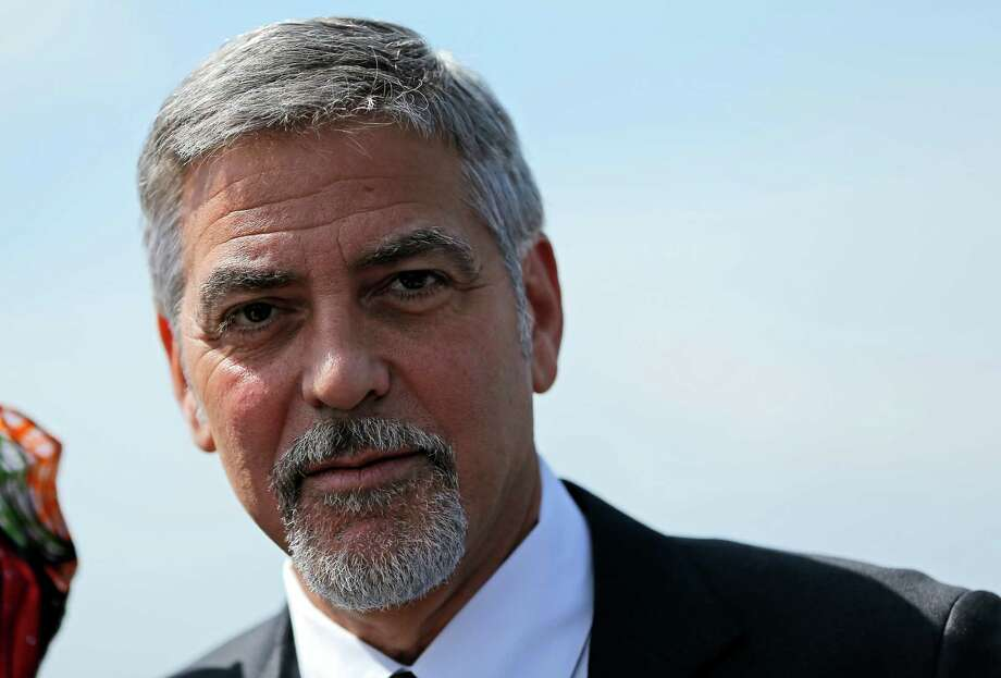 US actor George Clooney attends a ceremony at a memorial to Armenians killed by the Ottoman Turks, in Yerevan, Armenia on Sunday, April 24, 2016.  The killing of more than 200 Armenian intellectuals on April 24, 1915 is regarded as the start of the massacre that is widely viewed by historians as genocide. But modern Turkey, the successor to the Ottoman Empire, vehemently rejects the charge. Clooney has been a prominent voice in favor of countries recognizing the killings as genocide, which the United States has not done.(Vahan Stepanyan/ PAN Photo via AP) Photo: Vahan Stepanyan, Associated Press / PAN Photo