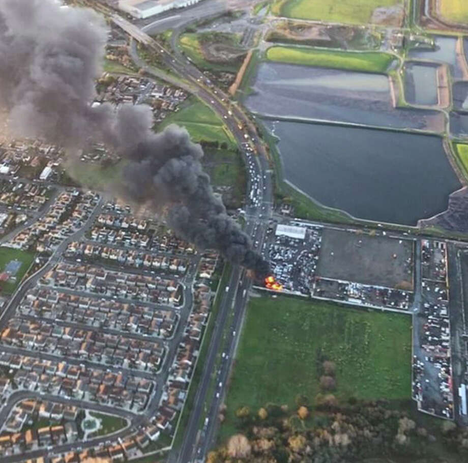 A junk yard fire in Richmond Friday morning was causing a large plume of black smoke across the  East Bay Friday morning. Photo: Sky 1 Ron / KCBS