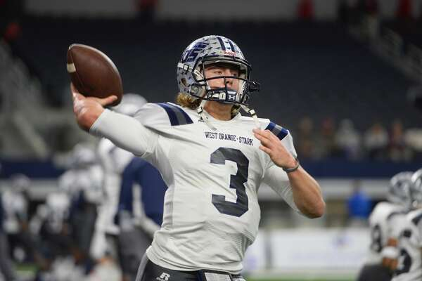 Quarterback Jack Dallas warms up before West Orange-Stark's state title game against Sweetwater Friday at AT&T Stadium in Arlington.  