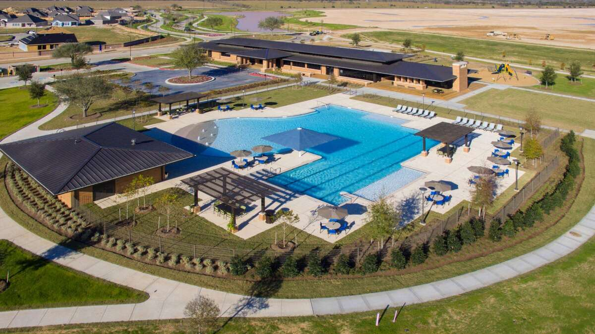 Elyson's amenities include a resort-style pool with beach entry.