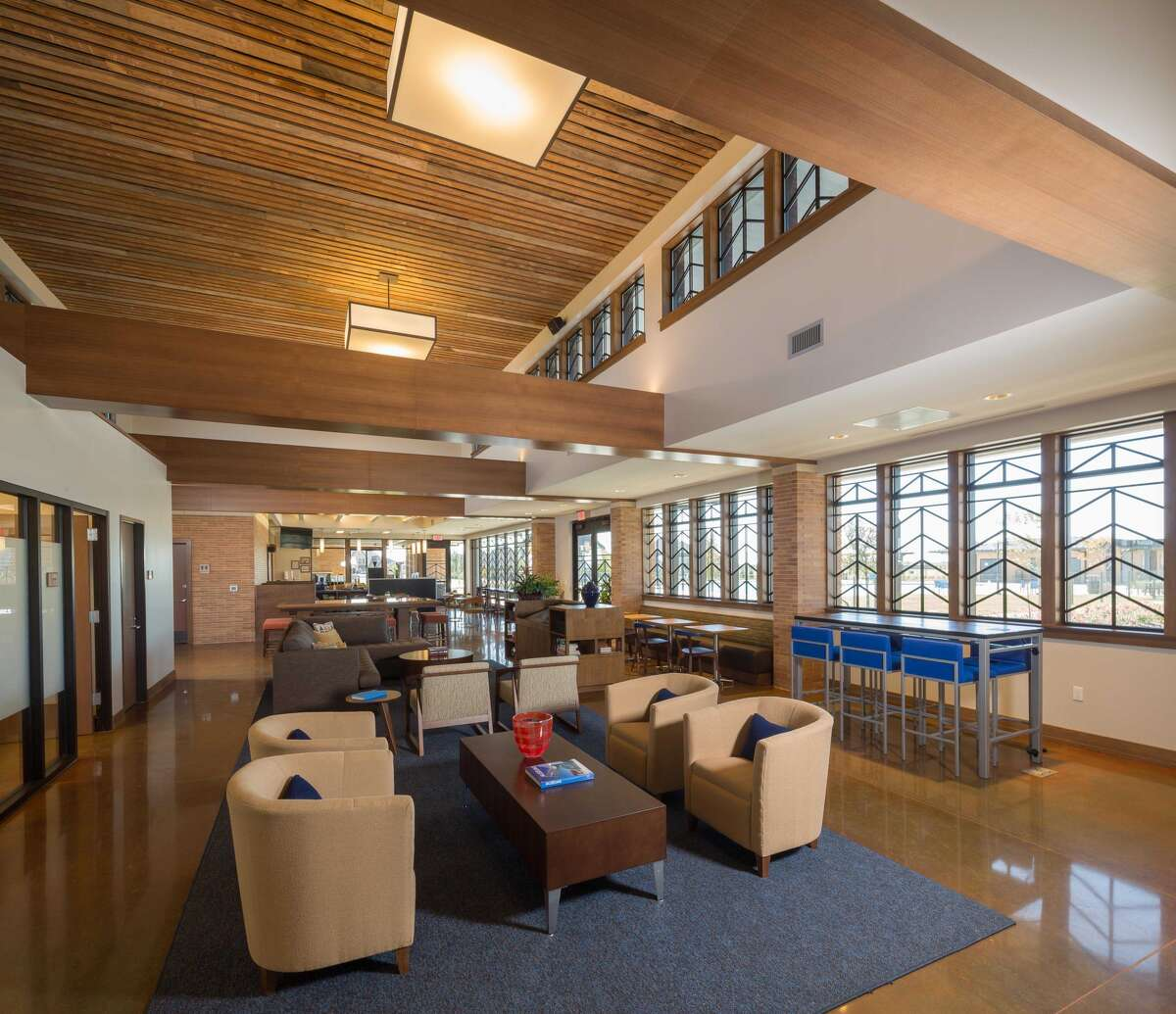 Rorick House, the 9,000-square-foot amenities center at Elyson, has areas for lounging, community meetings and games.