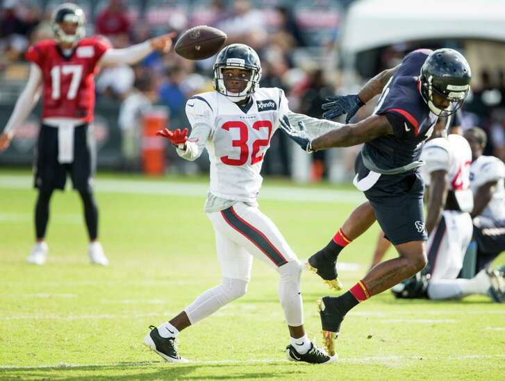 Houston Texans defensive back Robert Nelson (32) breaks up a pass intended for wide receiver Braxton Miller (13) during Texans training camp at Houston Methodist Training Center on Tuesday, Aug. 9, 2016, in Houston. ( Brett Coomer / Houston Chronicle )