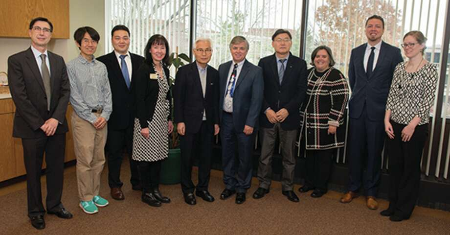 Dr. Cem Karacal, dean of the SIUE School of Engineering (SOE), Dr. Soondo Kweon, assistant professor in the SIUE SOE, Dr. Kyung-Sung Kim, assistant professor in the TU School of Engineering, Dr. Mary Weishaar, executive director of International Affairs at SIUE, TU Board Director Mr. Eui-Tack Suh, SIUE Chancellor Dr. Randy Pembrook, TU Vice President Dr. Tae-Jung Lho, SIUE Vice Chancellor for Academic Affairs Dr. Denise Cobb, and Dr. Ryan Hall and Ms. Sarah Van Alebeek, ESLi administrators. Photo: For The Intelligencer