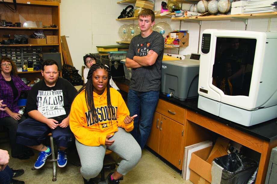 Southwestern Illinois College STEM Scholar Aliya Owens of East St. Louis, center, front, asked questions about a 3-D printer during a tour of the Belleville Campus recently. STEM Scholars in the background are, from left, Nancy Sewell of Waterloo, Kevin Brutto of Collinsville, Olivia Hood of Sparta and Jack Richards of Red Bud. The students toured sites of interest around the SWIC Belleville Campus to discover different education opportunities. STEM Scholars are a group of students who have earned tuition scholarships to study science, technology, engineering and math disciplines. They are paired with faculty mentors, participate in study groups, take part in off-campus activities, such as college visits, and enroll in special topics courses. SWIC received a more than $600,000 National Science Foundation S-STEM grant to develop the STEM Scholars Program. Photo: SWIC Photo