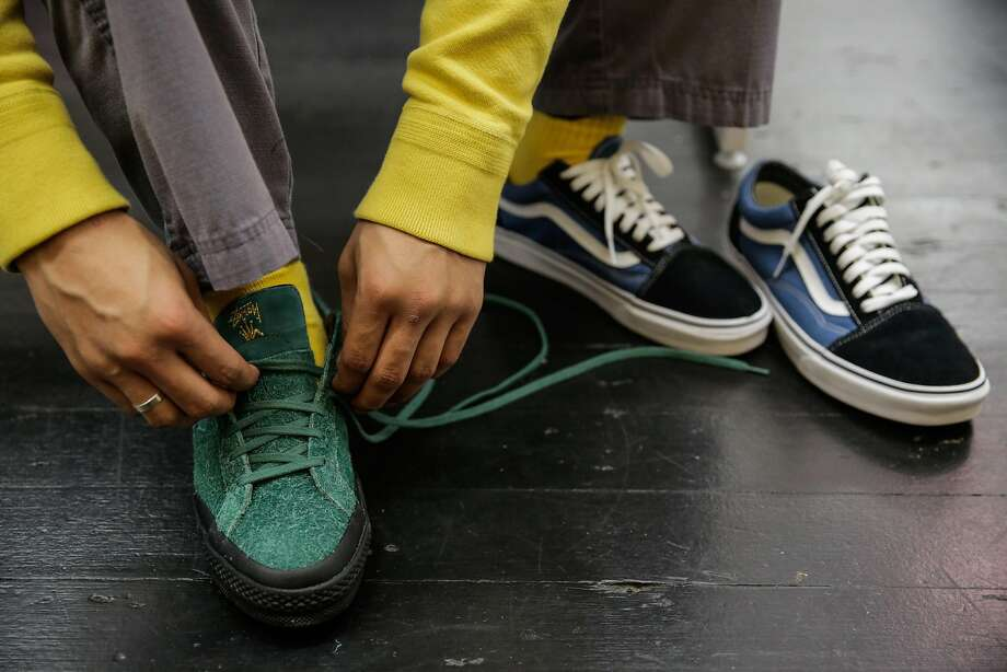 Employee Kyle Martin tries on a pair of sneakers at the end of his shift at