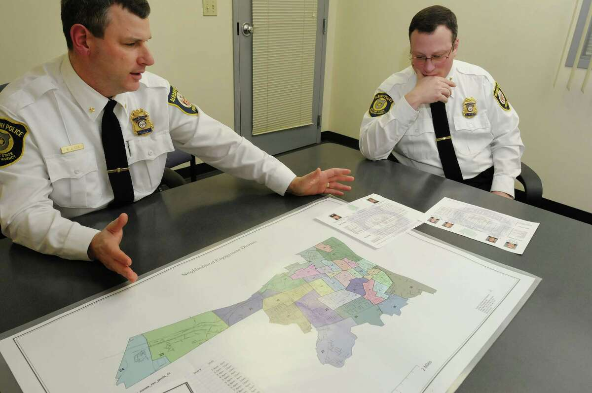 Albany Police Assistant Chief Brendan Cox, left, and Police Chief Steve Krokoff talk about crime data that the department is making public during an interview at the Albany Public Safety Building on Monday, Dec. 17, 2012, in Albany, N.Y. On the table is the department's neighborhood engagement districts map. (Paul Buckowski / Times Union archive)