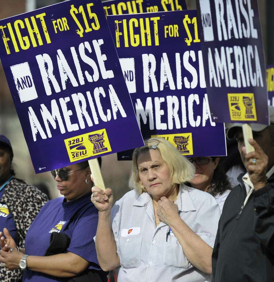 An April 2015 rally in Danbury supported an increase in the minimum wage. Photo: Carol Kaliff / Carol Kaliff / The News-Times