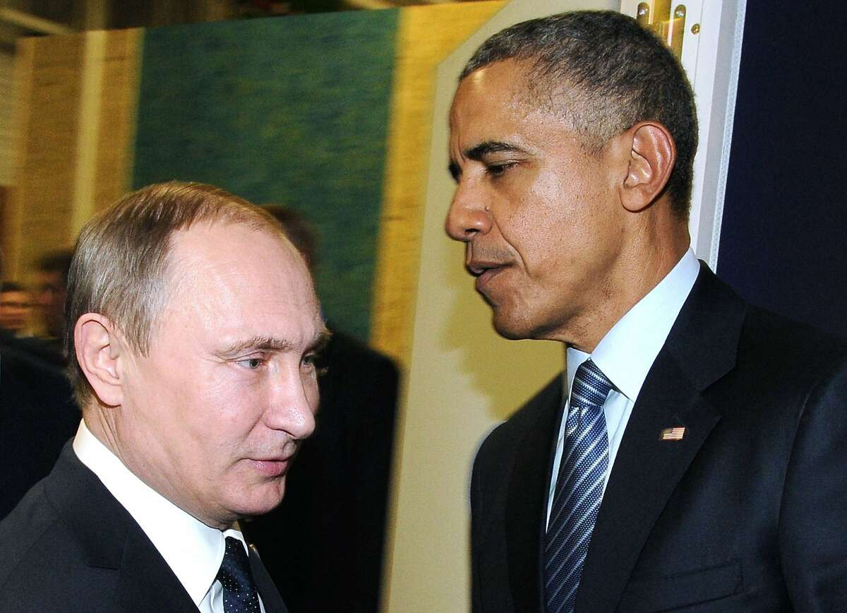 (FILES) This file photo taken on November 30, 2015 shows Russian President Vladimir Putin (L) meeting with US President Barack Obama on the sidelines of the UN conference on climate change - COP21 in Le Bourget, on the outskirts of the French capital Paris. Barack Obama on December 15, 2016 said the United States would retaliate against Russian hacking after the White House accused Vladimir Putin of direct involvement in cyberattacks designed to influence the US election. / AFP PHOTO / SPUTNIK / MIKHAIL KLIMENTYEVMIKHAIL KLIMENTYEV/AFP/Getty Images