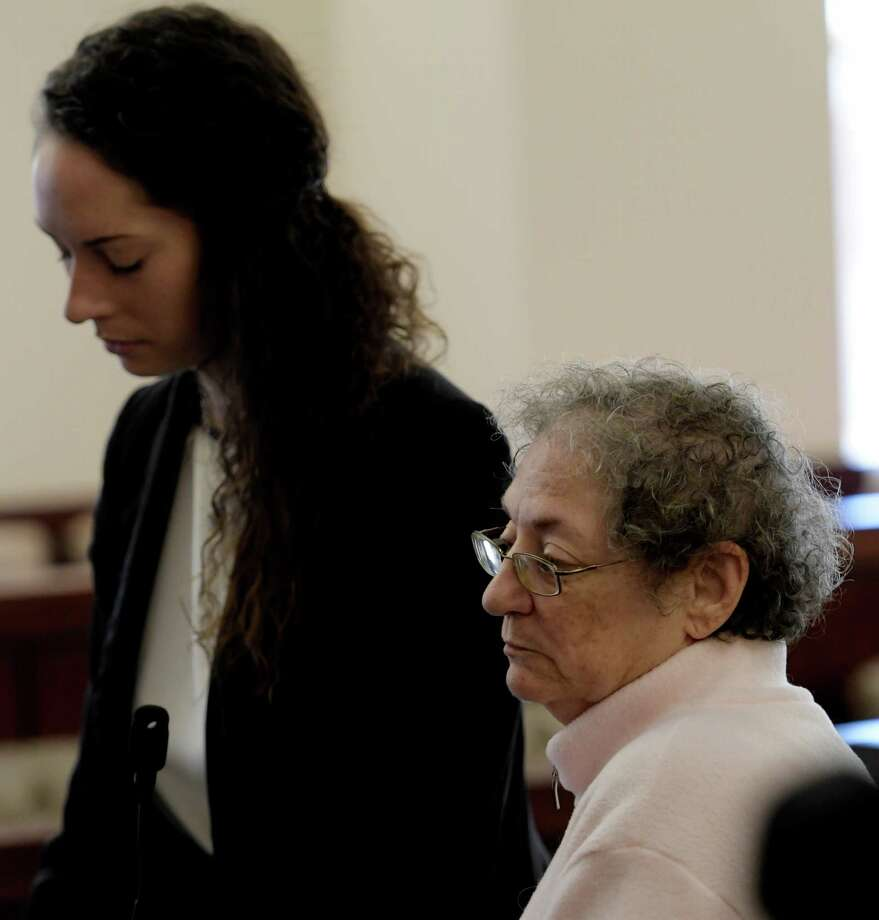 Renee Kanas, right, with her attorney Angela Kelley, left, receives her sentence for an alleged scam of almost $150,000 on Friday, Dec. 16, 2016, at the Albany Judicial Center in Albany, N.Y.  (Skip Dickstein/Times Union) Photo: SKIP DICKSTEIN / 20039171A