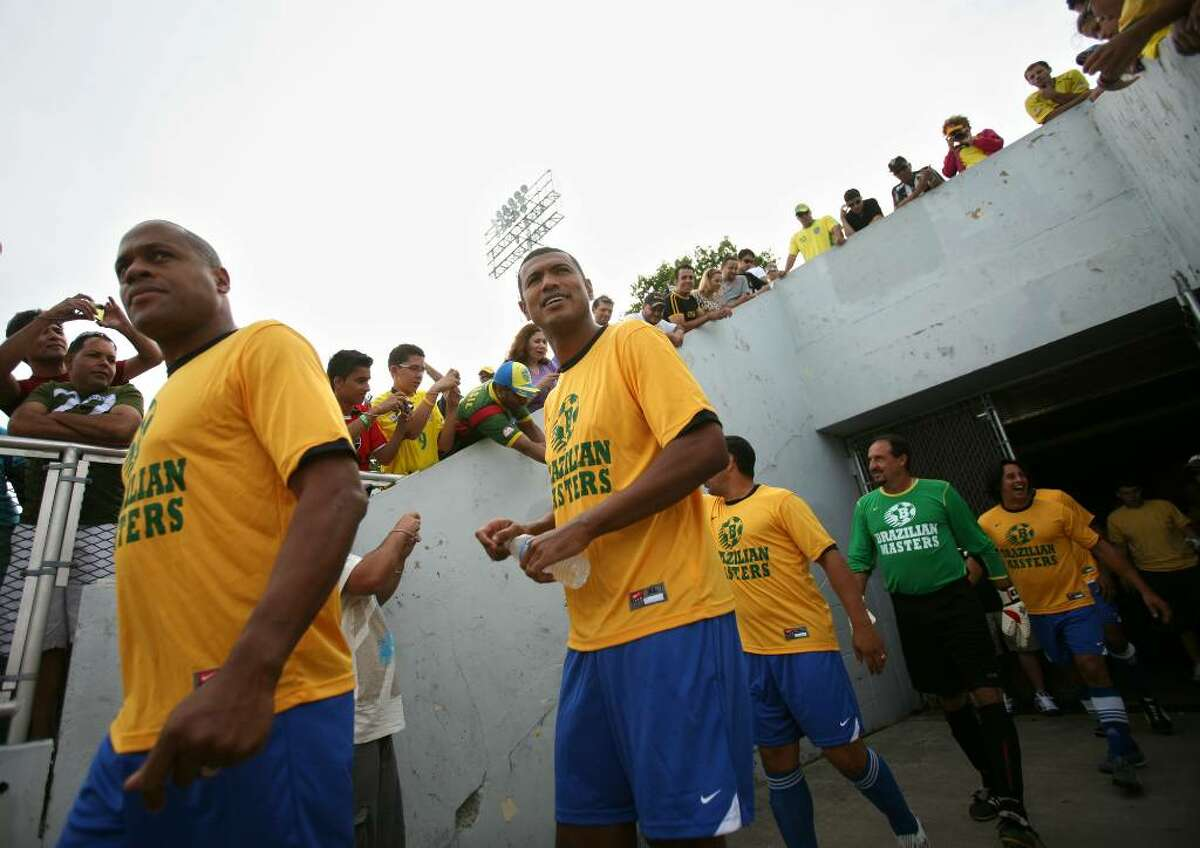 The Brazilian Masters soccer team heads out to the field for their game with the Bridgeport All Stars at Kennedy Stadium in Bridgeport on Sunday, May 23, 2010.