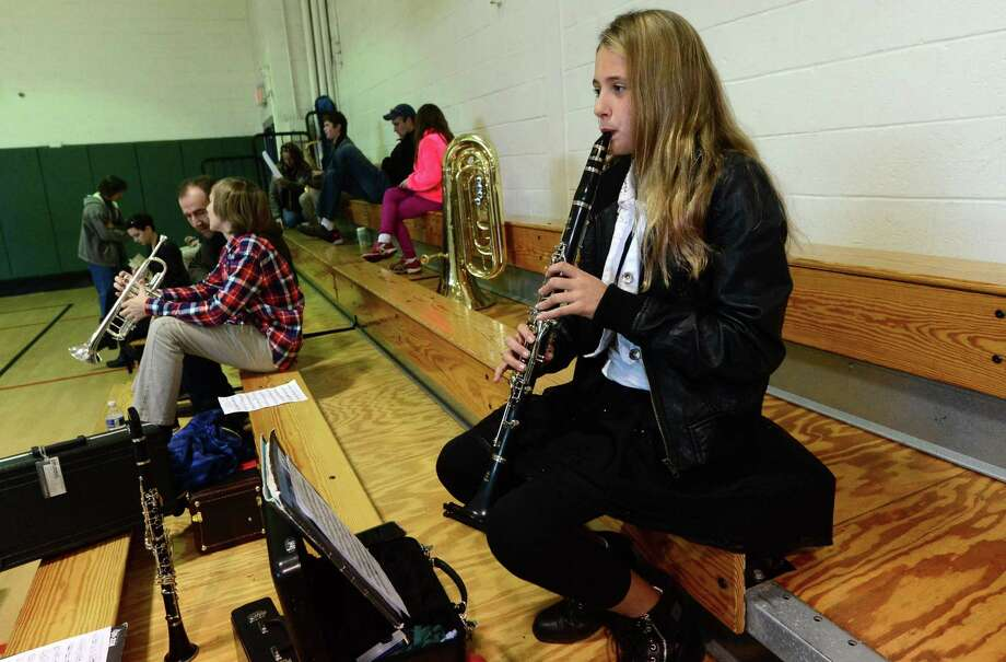 Clarinet player Anna Moody of Westport joins nearly 500 as they prepare to compete for a spot in the annual festival during auditions at Ponus Middle School Dec. 3 in Norwalk. Photo: Erik Trautmann / Hearst Connecticut Media / Norwalk Hour