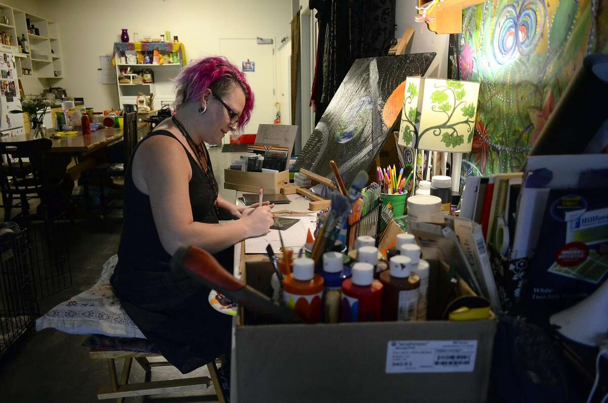 Lisa Mariel, painter and musician, works on hand painted cards for her customers out of her living space at the Tannery Art Center in Santa Cruz, CA, on Friday December 16, 2016. The Tannery gives artists an affordable space to work and live.