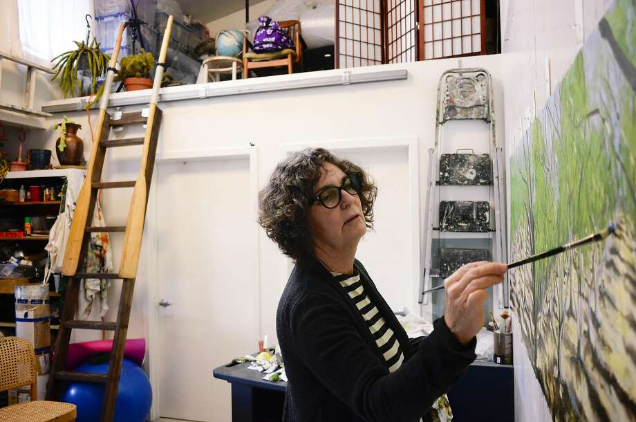 Margaret Niven, painter and teacher, works on an art piece in her living space at the Tannery Arts Center, an old tanning factory in Santa Cruz that was converted into live-work units for 100 low-income artists. Photo: Brandon Chew, Special To The Chronicle